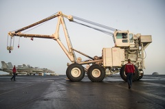 U.S. Sailors assigned to the crash and salvage team aboard the aircraft carrier USS Harry S. Truman (CVN 75) move the ship's mobile salvage crane on the flight deck March 9, 2014, in the Gulf of Oman 140309-N-GH675-002