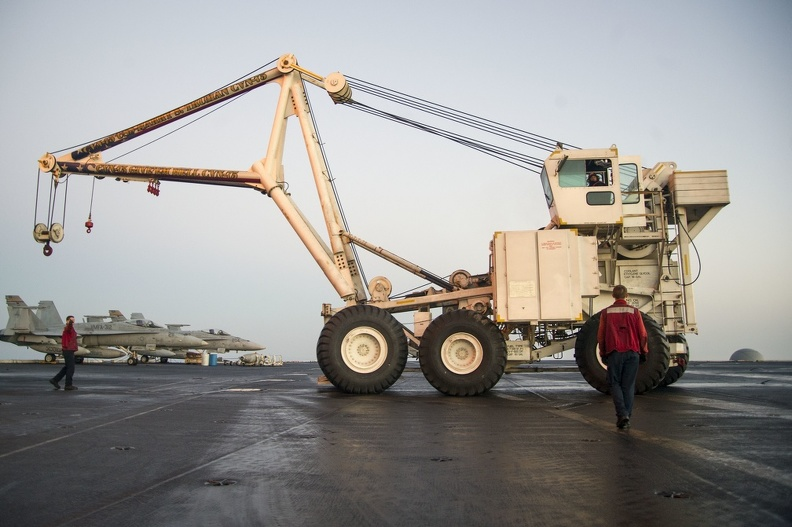 U.S._Sailors_assigned_to_the_crash_and_salvage_team_aboard_the_aircraft_carrier_USS_Harry_S._Truman_(CVN_75)_move_the_ship's_mobile_salvage_crane_on_the_flight_deck_March_9,_2014,_in_the_Gulf_of_Oman_140309-N-GH675-002.jpg